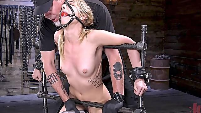 Slender model Kristen Scott reaches an orgasm from rough torture