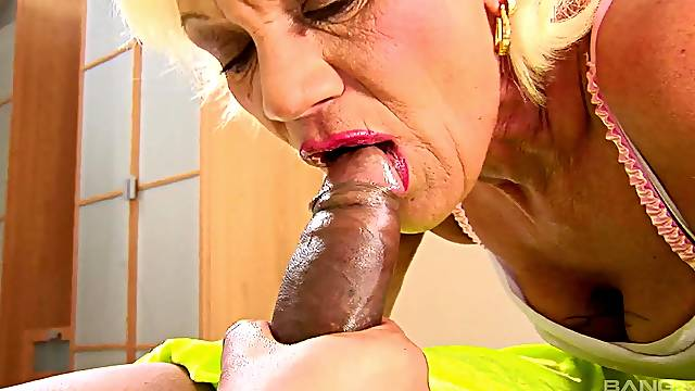 Dirty granny with hairy pussy having sex with a large black dick