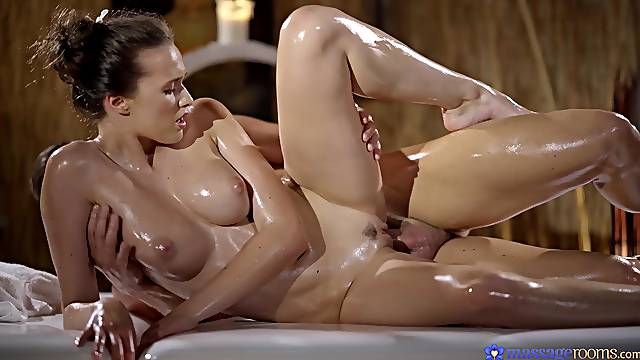 Passionate lovemaking during a massage with oiled Stacy Cruz