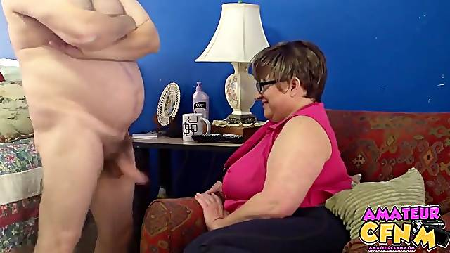 Fat mature Judith takes his dick in her hands to make him cum