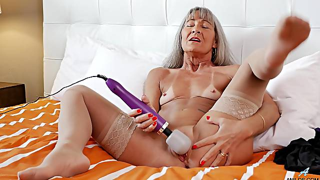 Dirty granny Leilani Lei spreads her legs to play with a vibrator