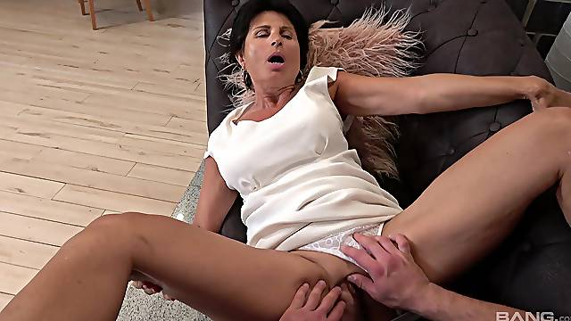 Dirty mature Petra spreads her legs to be fucked by a younger man