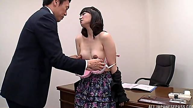 Provocative Asian secretary bends over the table to be fucked