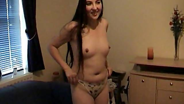 Small boobs amateur girl Dawn N drops her dress to have solo fun