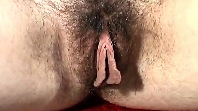 Hairy pussy amateur Honey B enjoys masturbating with a dildo