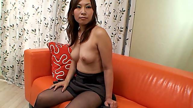 Solo Japanese chick Machiko opens her legs to tease with her hairy cunt