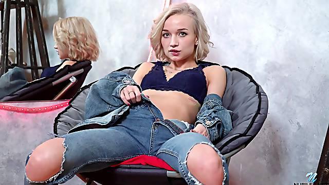 Seductive blonde model Monica Gold does a striptease and masturbates