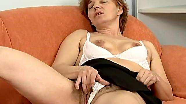 Granny enjoying her solace with a nice studded dildo