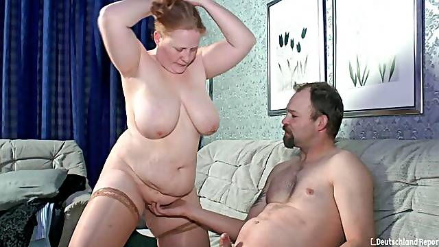 Big-boobed BBW Iris K. rides on a huge dick in the cowgirl pose