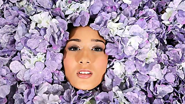 Among the petals lies beauty untold until now, as the lovely Darcia Lee lies on a bed covered in flowers, her mouth open to accept Joohn Syxs hard cock