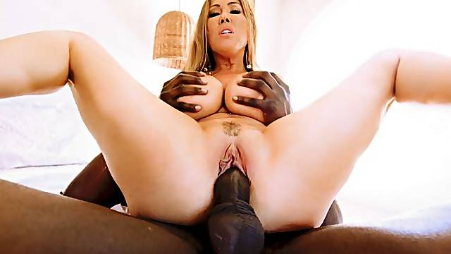 Super-buxom, bikini-clad Asian MILF Kianna Dior craves a full interracial pampering at the hands (and other key appendages) of experienced black stud Jax Slayher