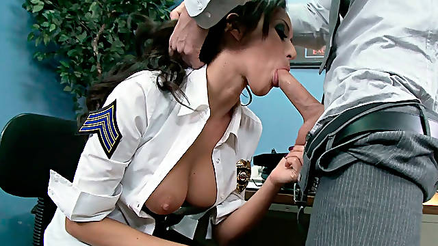 Horny police officer Breanne Benson gives head to her coworker