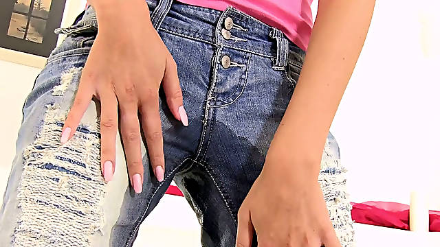 Charming girl Mistica makes her jeans wet and pissy