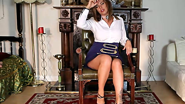 Sultry big boobed beauty in high heel shoes performs solo