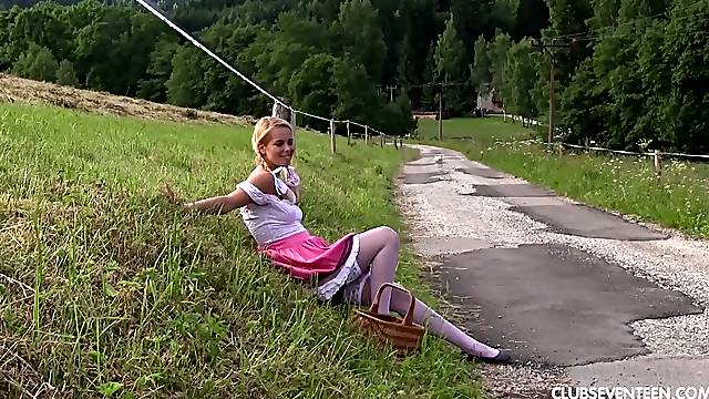 Sweet looking blonde in white stockings Nikki Dream is playing with her pussy outdoor