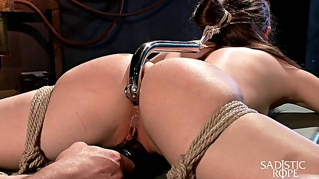 Dude fucks anus of Casey Calvert with metal hook and plays with her tied up body