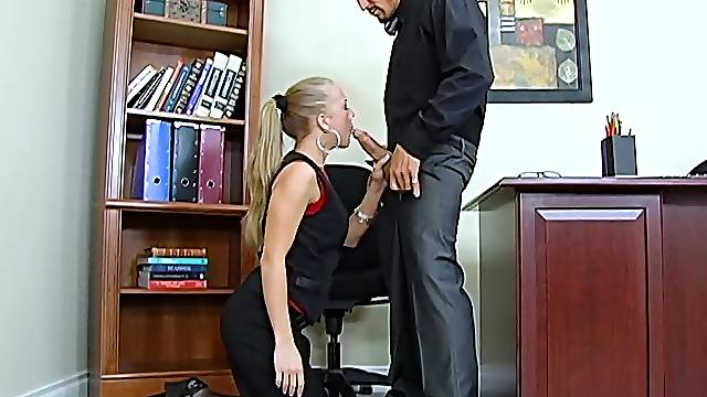 Sexy secretary Kylie Wilde gives a blowjob and gets fucked on the bosss table
