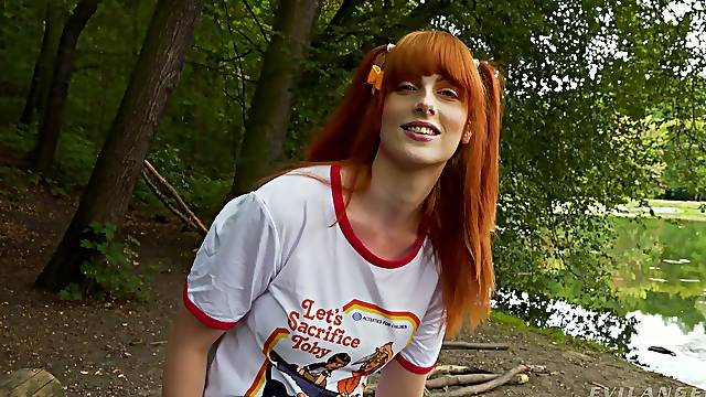 Orgasm craving redhead getting wild and naughty in the woods
