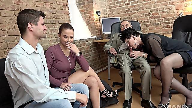 Mature couple shares young couple in foursome XXX