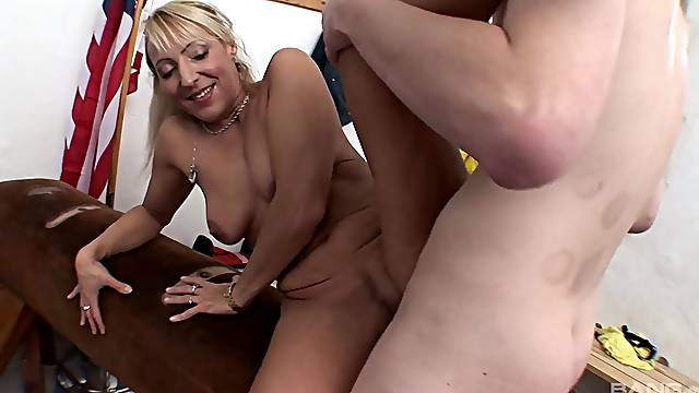 Nude blonde loads younger penis into her mature pussy and ass