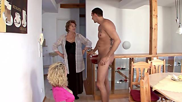 Mommy swallows a little after getting her hands on the young cock