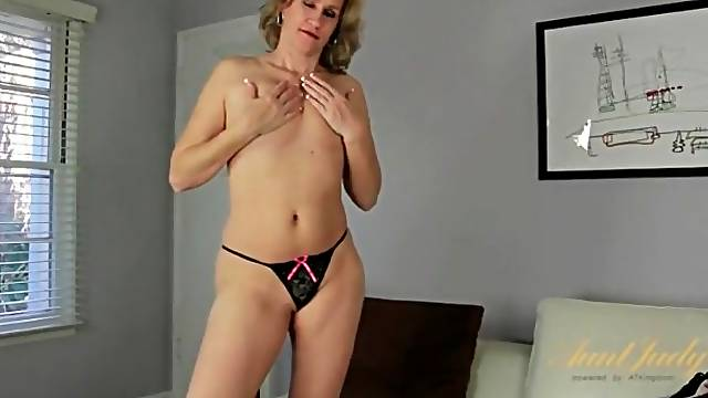 Curvy milf striptease with finger fucking