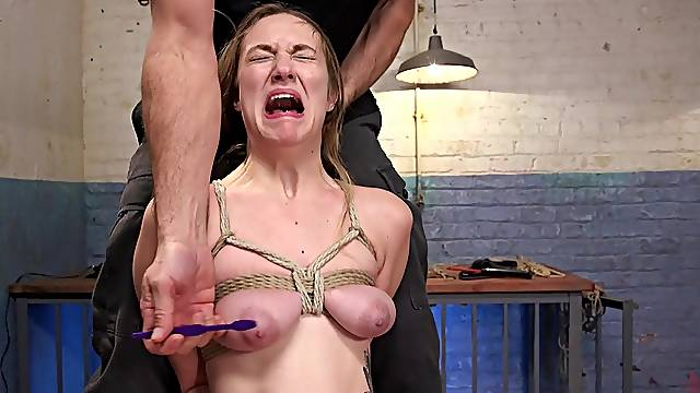 Busty girl screams in pain during rough maledom BDSM