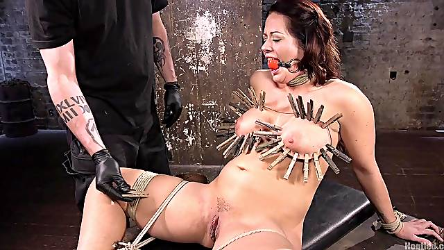 Clamped wife endures young man's cock in both holes
