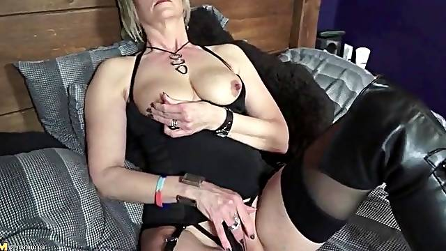 Black boots and lingerie on sexy blonde mature