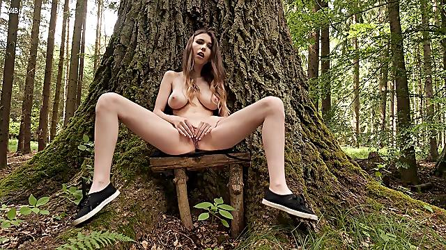 Aroused girl with big naturals, seductive solo into the woods