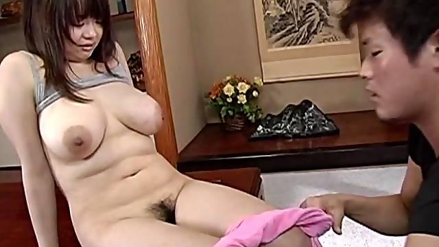 Busty Japanese devours whole cock like a pro