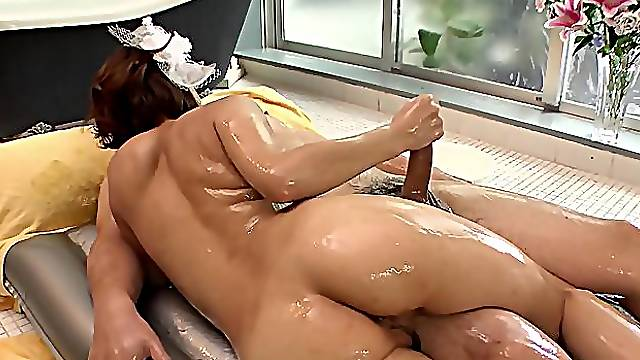 Dirty-minded Japanese girl turns oil massage into cocksucking
