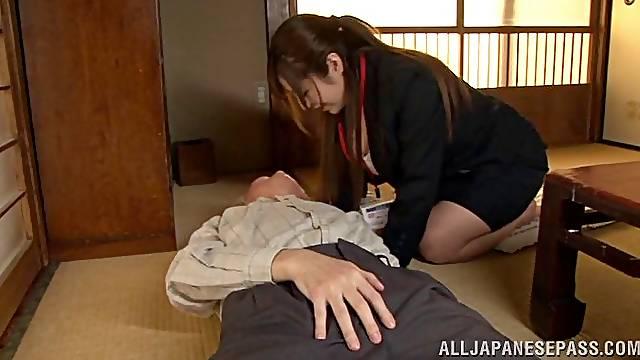Kissing an old Japanese man while giving him a handjob