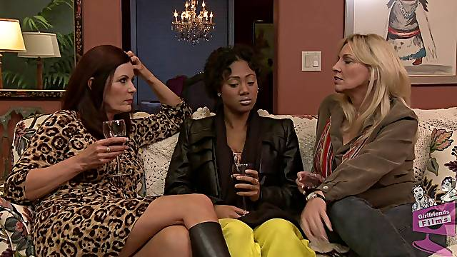 Ebony-skinned lesbian with big boobs enjoying a hardcore threesome