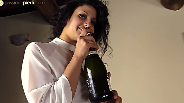 Her Italian feet are beautiful and sexy as she plays with a bottle