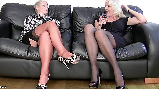 Cute mature lesbian couple in nylon stockings smashing each other with toys