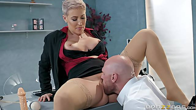 Short haired blonde secretary Ryan Keely gets cum on tits in an office