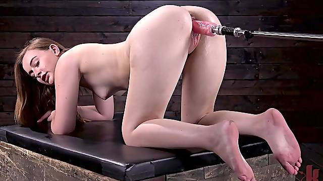 Gorgeous redhead slut Danni Rivers gets machine fucked in a dungeon