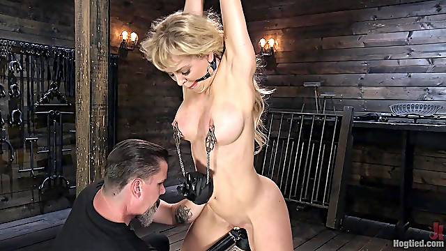 Mature submissive bombshell Cherie Deville abused in extreme bondage