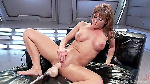 Busty Ariel X pleasures herself with a vibrator and a fuck machine