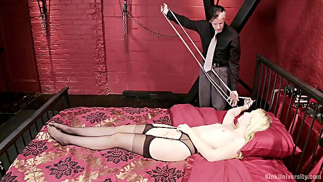 Petite blonde slave Samantha Rone tied up to the bed and pleasured