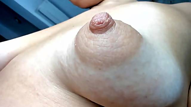 showing off her hot puffy tits and enjoying her lovense vibrator