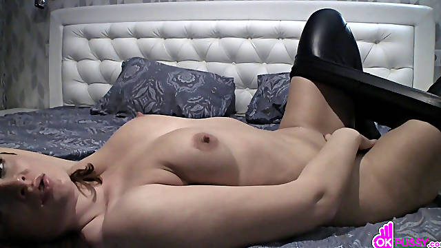 Redhead goth chick takes her clothes off until she's in leather pants