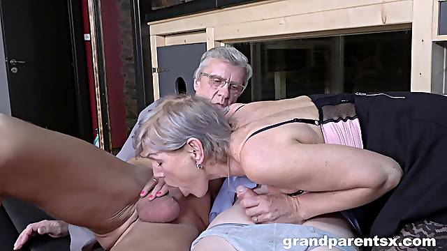 Dirty foursome fucking with an older couple and a sexy chick