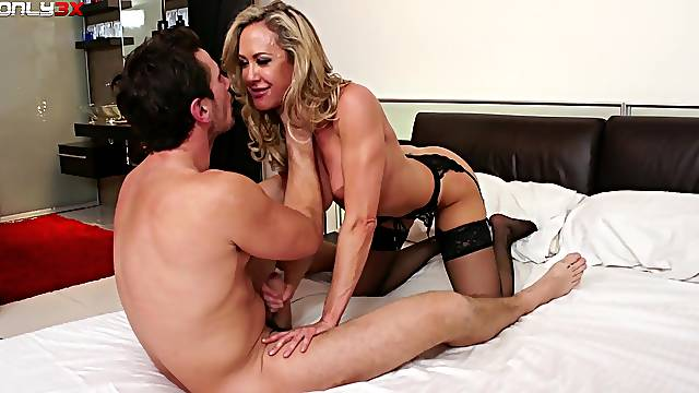 Cougar Brandi Love in stockings and lingerie having sex on the bed