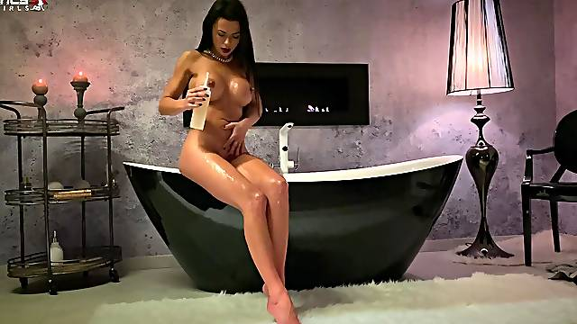 Solo model Shalina Devine with large tits plays with her dildo