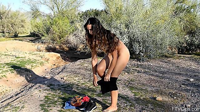 Flexible solo model Angelena opens her legs in a public park
