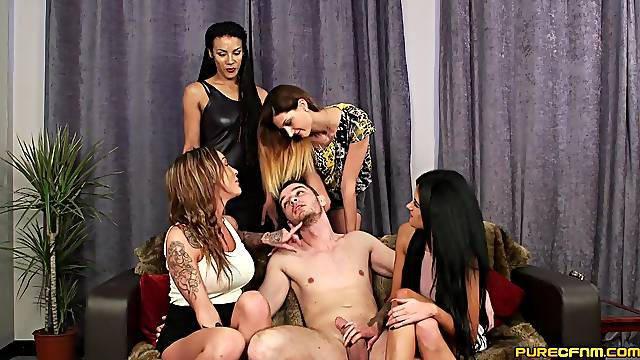 Lot of horny girls team up to pleasure one naked dude's penis