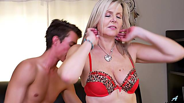 Mature slut Velvet Skye gets fucked by a younger lover on the bed