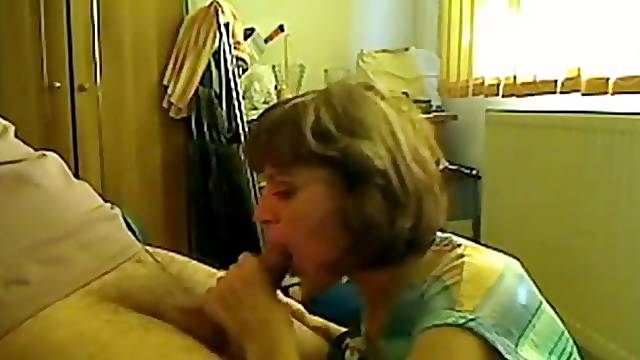 Hot mom giving blowjob to her young neighbor while hubby is at work